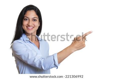 Pointing turkish businesswoman - stock photo