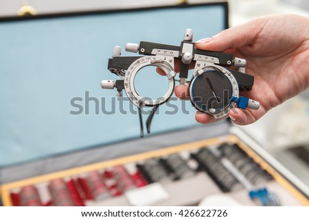 Points to check in the hand of a woman doctor. Close-up - stock photo
