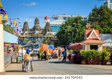 POIPET, CAMBODIA  NOVEMBER 29, 2011: Border crossing between Thailand and Cambodia in the city of Poipet. It is rated as one of the most scammed borders in South East Asia. - stock photo