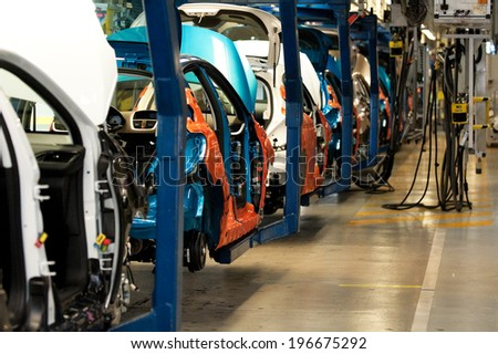 POISSY, FRANCE - JANUARY 27, 2012 - Assembly line  of cars Peugeot 207 and 208 at the Poissy factory of PSA Peugeot Citroen.