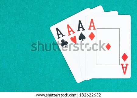 poker aces cards on green gaming table, concept of poker game with space for text - stock photo
