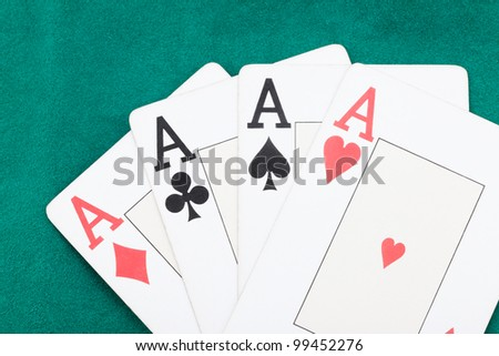 poker aces on green background