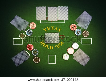 Poker cards and chips lying on green poker cloth. Texas Hold'em. - stock photo