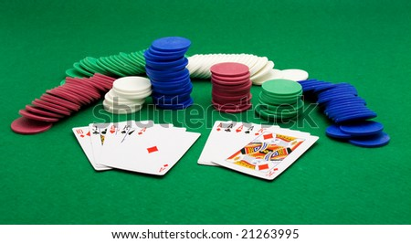 poker cards and chips on green table