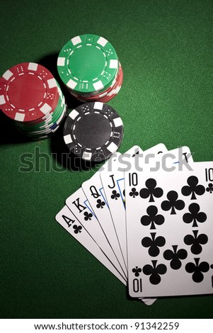 Poker cards and gambling chips on green background - stock photo