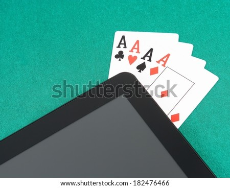 poker cards near digital tablet pc on green table, concept of  poker online - stock photo