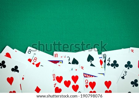 poker cards on green casino table - stock photo