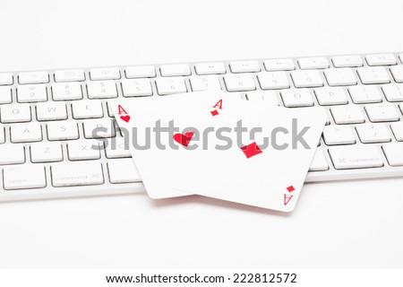 Poker cards on web keyboard on white background - stock photo