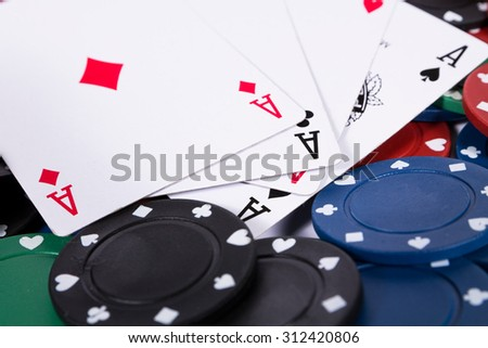 Poker chips and cards on white background - stock photo