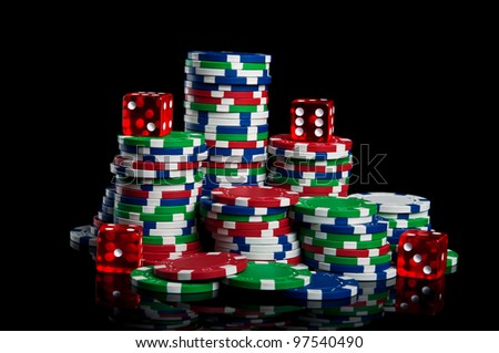 poker chips isolated on a black background - stock photo