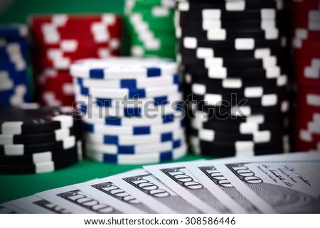 Poker Chips on a gaming table with dollars