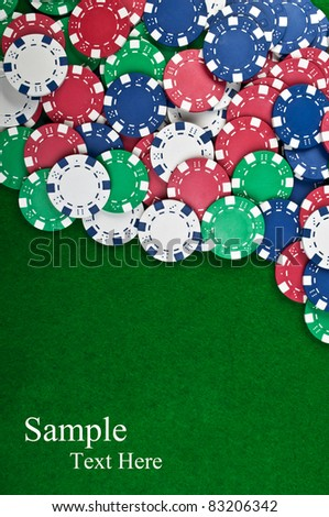 poker chips on a green table background