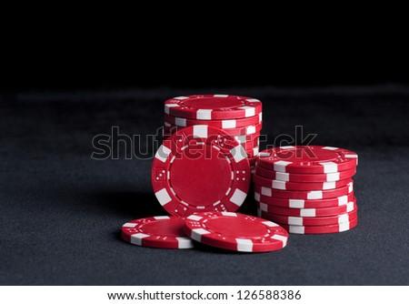 Poker chips on black - stock photo