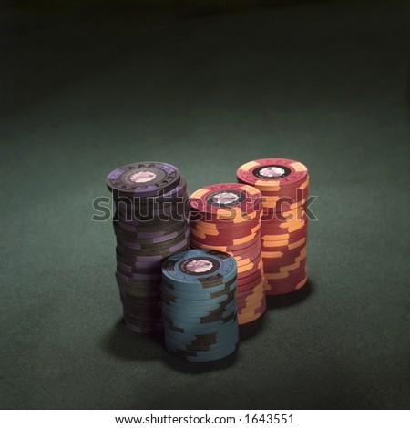 Poker chips on felt. - stock photo