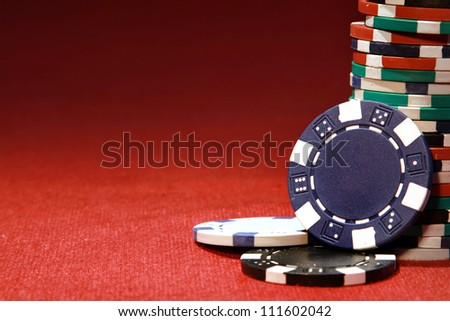 Poker chips on red background with place for sample text - stock photo