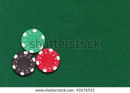 poker chips over table layout - stock photo