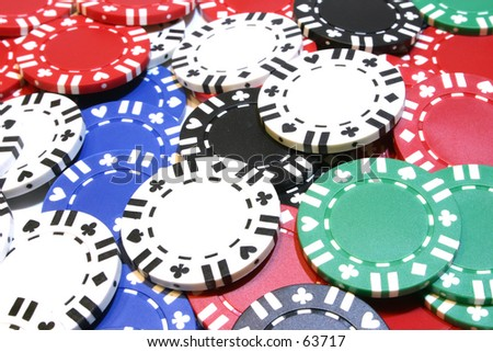 Poker chips scattered on table
