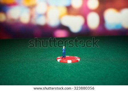 Poker chips with character on table in casino - stock photo