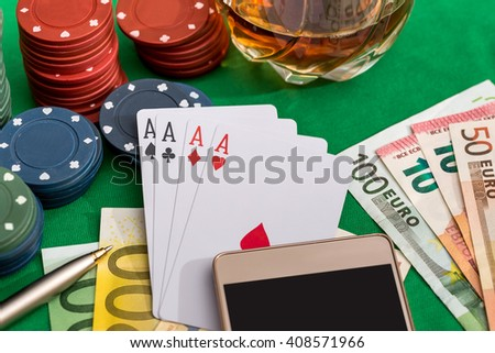 poker chips with playing card, euro money and smartphone