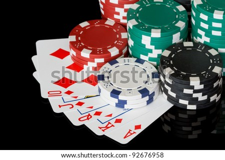 poker chips with royal flush - stock photo