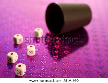 Poker dices over colored background, selective focus - stock photo