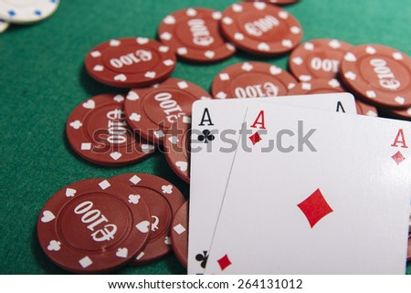 Poker game. Playing cards on a green table casino