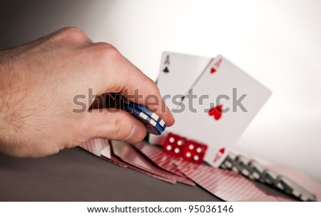 poker hand betting with winning hand a pair of aces - stock photo