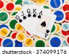 Poker hand with a straight flush in spades fanned over a colorful background of poker chips conceptual of winning at cards and gambling, overhead view - stock photo