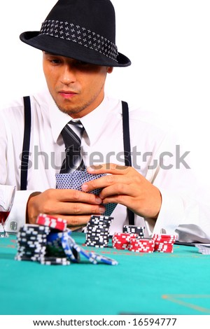 Poker In Style Young man playing poker with a hat and stylish suit. Isolated over white background. - stock photo