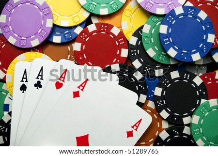 poker of aces on many chips