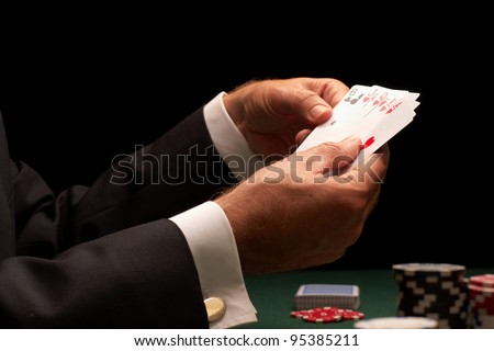 poker player gambling casino chips on green felt background selective focus - stock photo