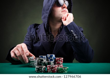 Poker player on black background