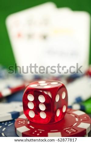 Poker red dice on stack of casino chips - macro shot - stock photo