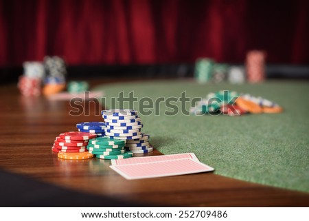 Poker Table / Gambling chips and poker table in a Casino - stock photo