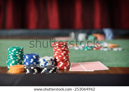 Poker table / Gambling chips in a casino - stock photo