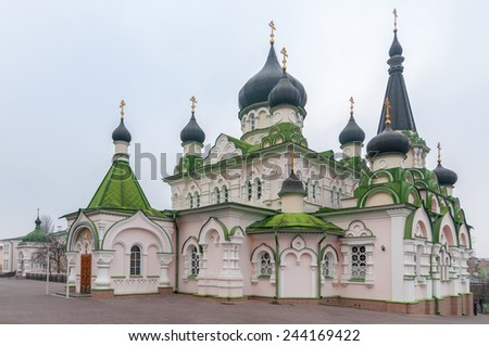 Pokrovsky Monastery, Orthodox Cathedral with a green roof and black domes. Ukraine, Kiev, Kyiv. - stock photo