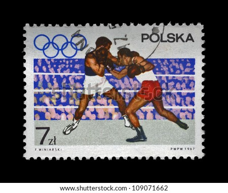 POLAND - CIRCA 1967: A cancelled stamp printed in Poland shows boxers on the Olympic ring devoted to 19th Olympic Games (Mexico City, 1968), circa 1967.