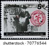 POLAND - CIRCA 1984: A post stamp printed in Poland shows a scout taking mail, series 40th anniversary of Warsaw Uprising, circa 1984 - stock photo