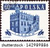 "POLAND - CIRCA 1958: A stamp printed in Poland from the ""Ancient Polish Town Halls"" issue shows Tarnow, circa 1958. - stock photo"