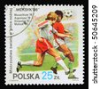 POLAND - CIRCA 1986: A stamp printed in Poland showing football match circa 1986 - stock photo