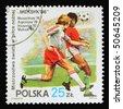 POLAND - CIRCA 1986: A stamp printed in Poland showing football match circa 1986 - stock photo