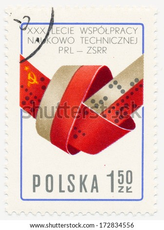 POLAND - CIRCA 1977: A stamp printed in Poland shows Flags of USSR and Poland as Computer Tape, circa 1977 - stock photo