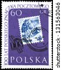 "POLAND - CIRCA 1960: A stamp printed in Poland shows Skier on the Stamp of 1939, with inscription and name of series ""Centenary of Polish stamps"", circa 1960 - stock photo"