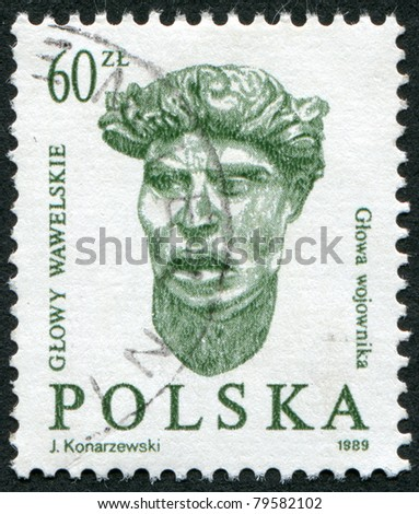 POLAND - CIRCA 1989: A stamp printed in the Poland, shows a male head of the embassy of the hall of the castle Wawel in Krakow, circa 1989 - stock photo