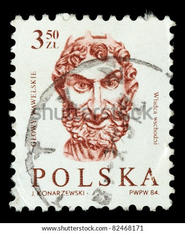 POLAND - CIRCA 1984: A stamp printed in the Poland, shows a male head of the embassy of the hall of the castle Wawel in Krakow, circa 1984 - stock photo
