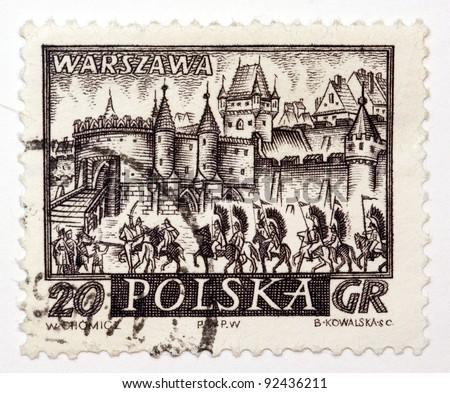 POLAND - CIRCA 1950: A stamps printed in Poland, shows medieval town Warszawa, Poland, circa 1950 - stock photo