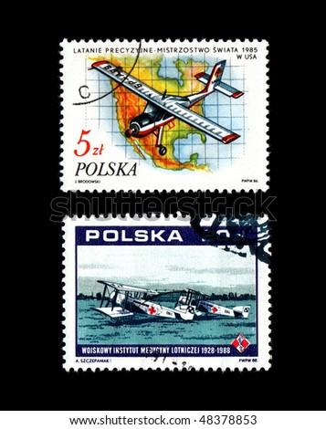 POLAND - CIRCA 1985: Biplane Air Postage Stamp Isolated on Black Airplane Flight, circa 1985 Poland