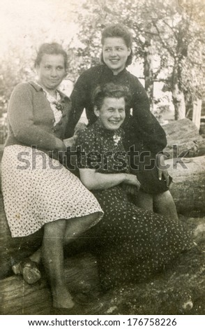 POLAND, CIRCA FORTIES - Vintage photo of three women outdoor