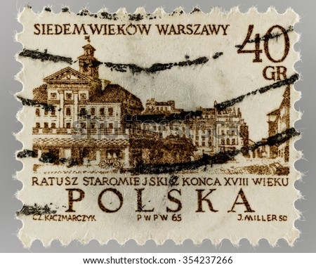 POLAND - CIRCA 1965: used post stamp of POLAND . Texts of stamp : POLAND ; 700th anniversary of Warsaw ; Old Town Hall , end of 18th century ;  0,4 zloty  . Image of stamp contains Old Town Hall .