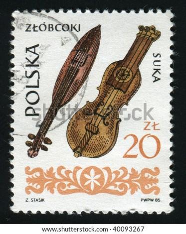POLAND -CIRCA 1984: Wooden musical instrument. Ancient wooden lute, circa 1984. - stock photo